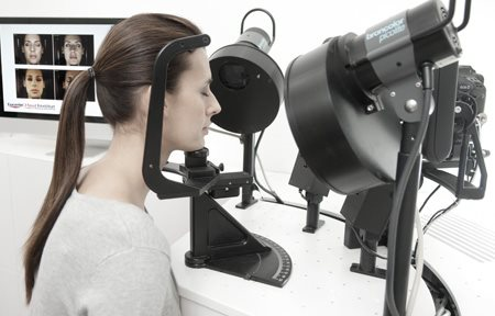 Woman´s face gets checked with high-tech apparatus