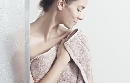 Woman wrapped in a towel.
