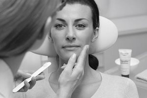 Woman´s face gets treated with Eucerin product