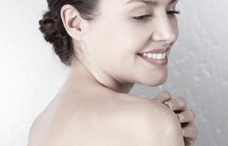 Women showering and foaming her shoulder
