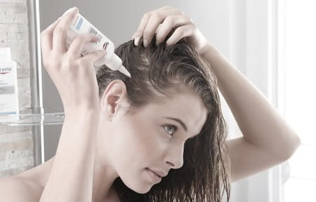Women applying product to scalp