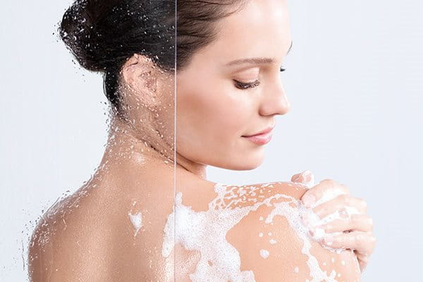 Woman using cleanser for sensitive skin