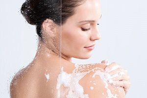 Woman uses shower body oil cleanser sensitive skin