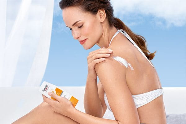 Apply sunscreen body lotion for dry skin
