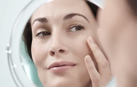 Woman applies Eucerin Volume-Filler Eye Care