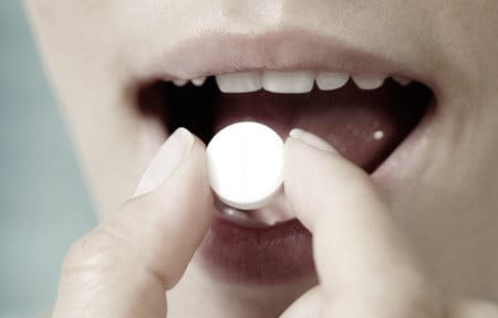 Woman eating pill