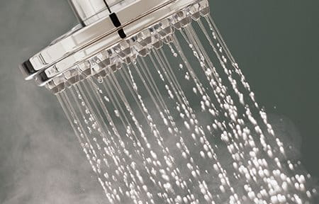Steaming water coming out of a shower head
