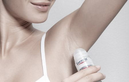 Woman using Eucerin 48 h Anti-Transpirant Roll-on